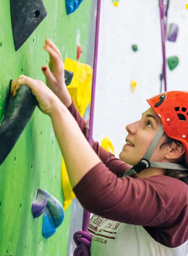 A woman rock wall climbing