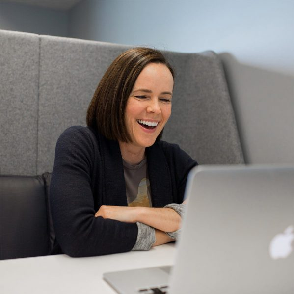 A woman smiling during a video call