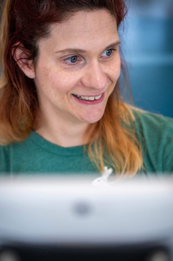A woman smiling during a videoconference